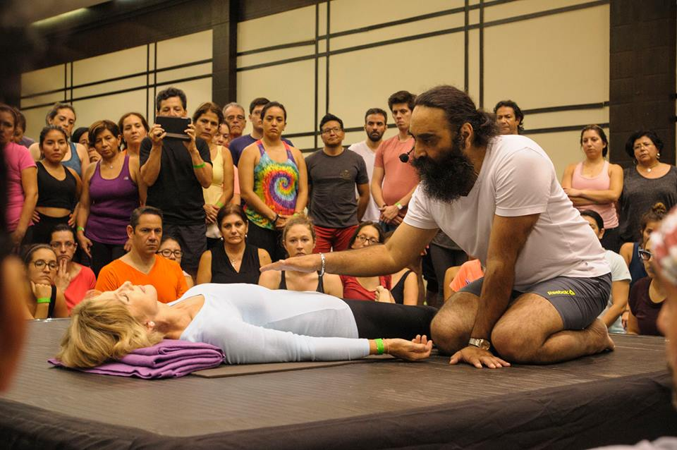 Surinder Singh conducts a yoga class at a yoga conference